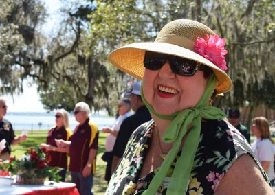 Happy resident at Moosehaven Retirement Community event by the St. Johns River